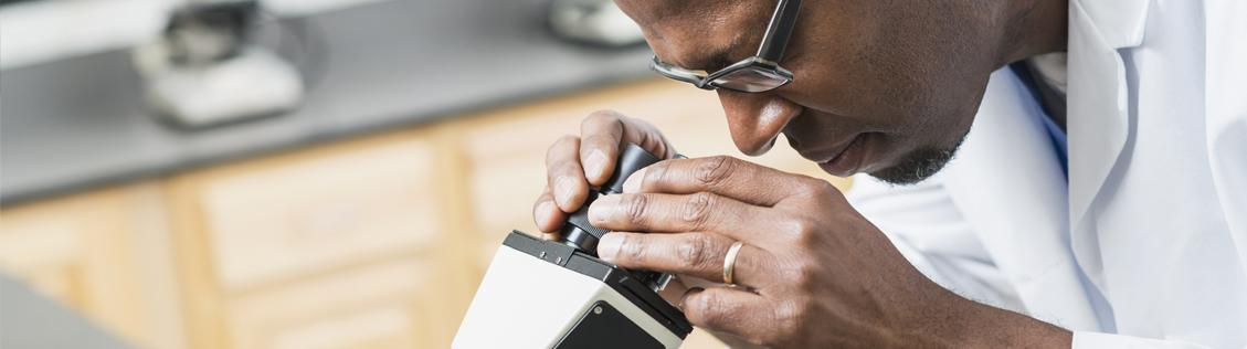 doctor using a microscope